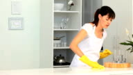 Woman cleaning her kitchen with boyfriend video