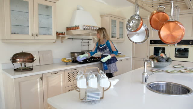 Woman cleans the cooker in kitchen video