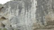 Woman climber climbs a cliff video