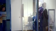 Woman comes to the store window at the mall video