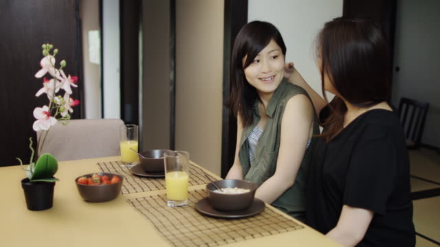 Woman Comforting Girlfriend Over Breakfast video
