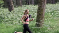 SLO MO DS Woman competing in a trail run marathon video