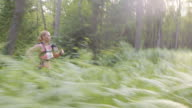 TS Woman competing in marathon in forest video