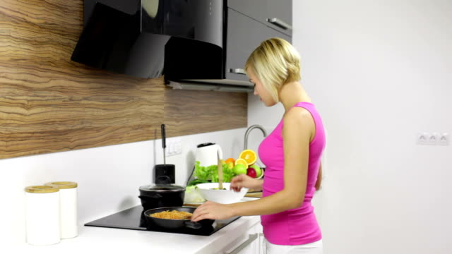 woman cook, young pretty girl modern kitchen prepare dinner home video