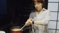 Woman Cooking and Checking Time video