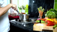 Woman cooking with kitchenware, variety vegetable in kitchen / activity & healthy lifestyle conceptual video