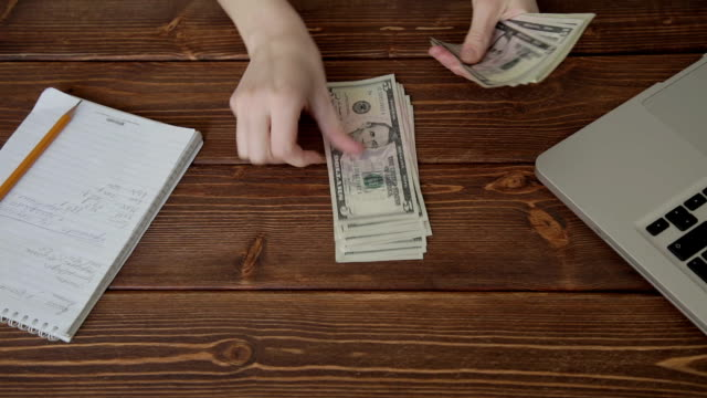 Woman counting money video