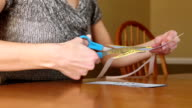 Woman Cutting Coupons video