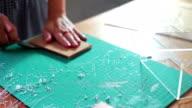Woman cutting pattern on acrylic sheet video