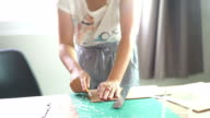 Woman cutting pattern on acrylic sheet with Plastic Cutting Tools. video