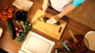 Woman cutting zucchini. Cooking homemade ratatouille. Healthy eating concept. FullHD video video