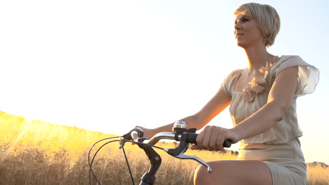 HD SUPER SLOW MO: Woman Cycling In Countryside video