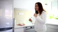 Woman dancing at home and singing video