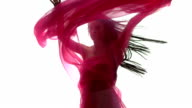 Woman dancing with pink fabric video