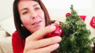 Woman decorating her Christmas tree video