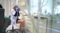 Woman Dentist is preparing for inspection at dentist clinic video