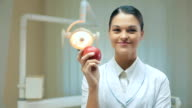 Woman dentist with apple video