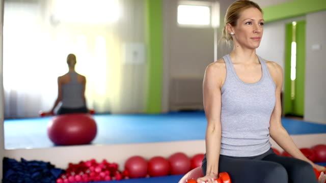 Woman doign Pilates exercises. video