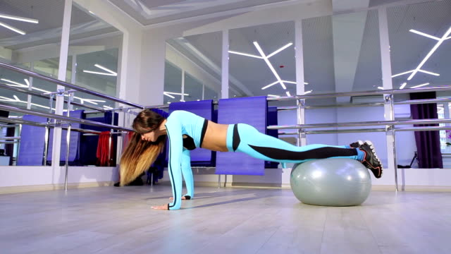 Woman doing exercise in the gym. video