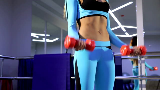 Woman doing exercise with barbell in the gym. video