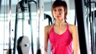 Woman doing exercise with machine at the gym video