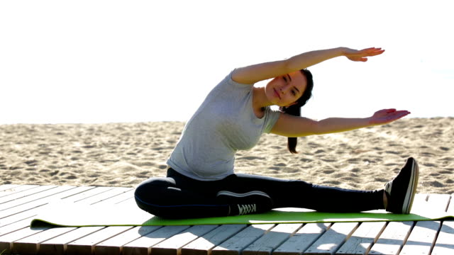 woman doing exercises on beach video