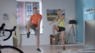 Woman doing her workout with personal trainer video