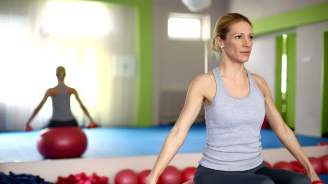Woman doing Pilates exercises. video