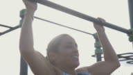 Woman doing pull-ups video