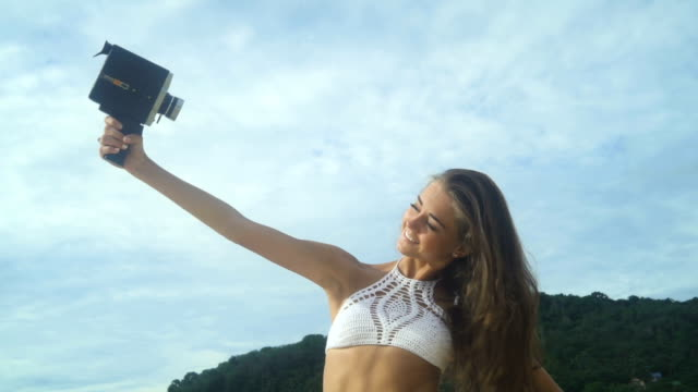 Woman Doing Selfie With Retro Vintage Camera video