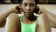 Woman doing series of crunch in gym video