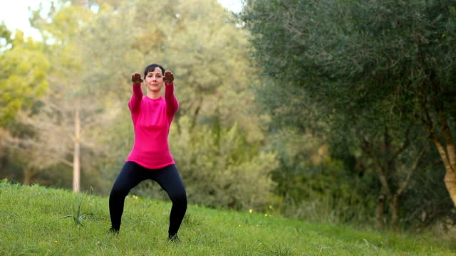 woman doing sport exercising in the park video
