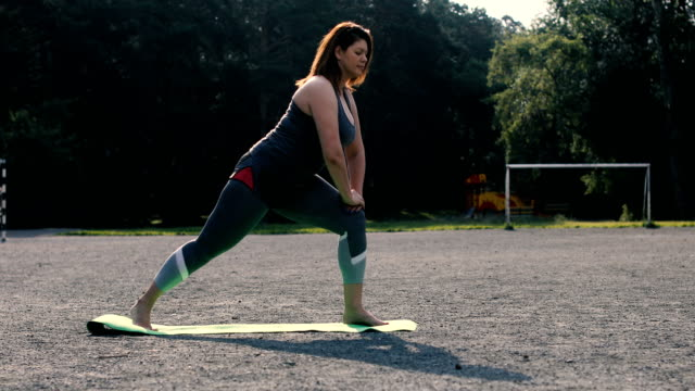 Woman doing stretches to prepare for her workout video