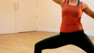 Woman doing stretching exercise on exercise mat video
