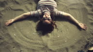 Woman doing the sand angel video