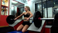 Woman doing weight training video