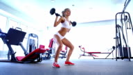 Woman doing workout with barbell video