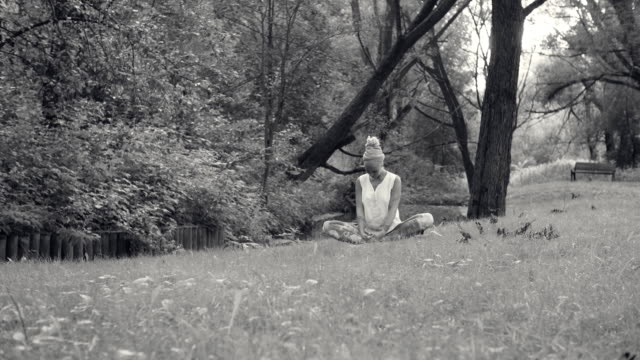 Woman doing yoga exercises near the river video