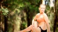 Woman doing yoga outdoors. video