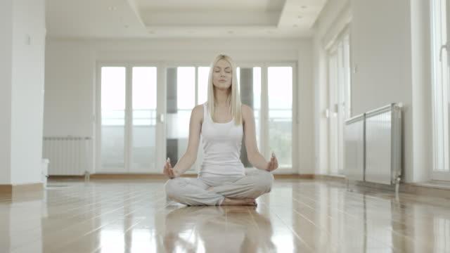 Woman doing yoga video