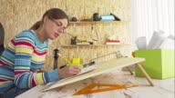 Woman drawing using drawing board video