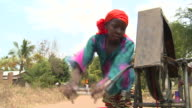 woman drawing water from a well video