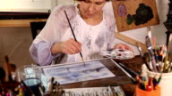 Woman drawing with watercolors video