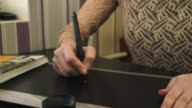 Woman draws on the tablet, smooth panorama video
