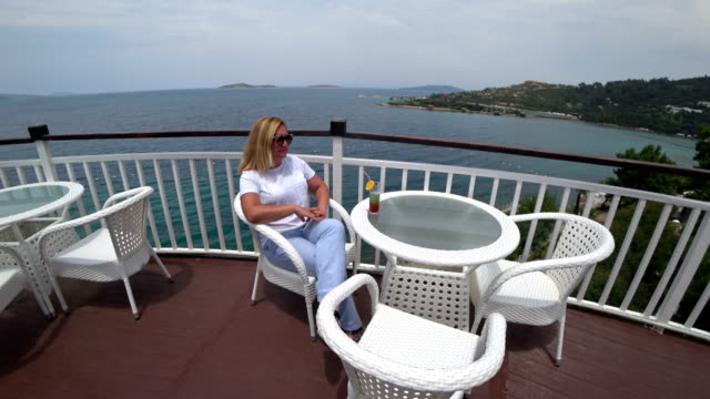 Woman drinking cocktail at the outdoor video