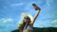 Woman Drinking Coconut Milk During Tropical Vacation video
