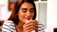 Woman drinking coffee video