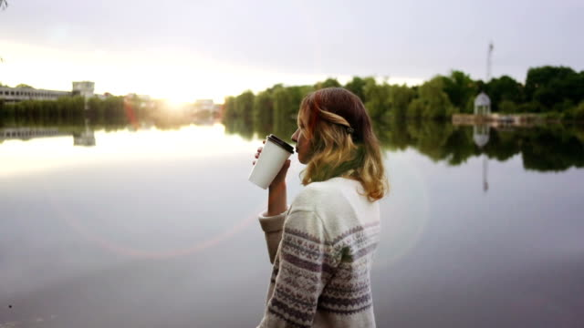 Woman drinking coffee video