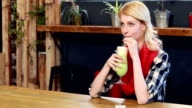 Woman drinking green milkshake video