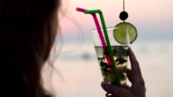 Woman drinking mojito with a straw video